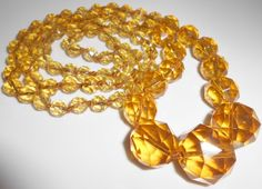 Faceted Amber Glass Graduating Endless by Libbysmomsvintage