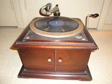 We actually had one of these hand-cranked 78rpm record players and the 78s to go with it when I was in Primary School