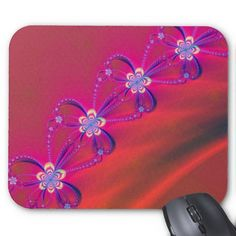 Pink and Yellow Striped Flower Fractal Mouse Pad-This beautiful pink and yellow striped flower fractal design will surely catch everyone's attention. The purple loops around the flowers resemble bows or maybe even butterflies. The pink background which gradually turns orange gives the illusion that the flowers might be connected by a ribbon and they are floating through the air.