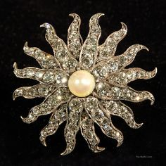 """Antique Tiffany & Co. Diamond Brooch. """"Snowflake"""" style brooch with natural pearl and approximately 10 cts of full cut, old European cut diamonds, set in silver and gold. Diamond, natural pearl, set in silver and gold, USA, 1910s."""