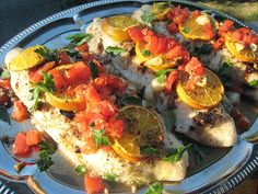 Basa Fillets with Olives, Tomatoes, Lemons and Oranges, Salt&Pepper, of course, Olive oil 44 min at 400F