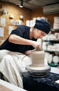 Throwing clay on the pottery wheel is an enjoyable and challenging part of ceramics.