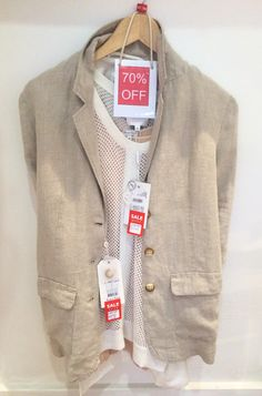 Nude support vest by Part Two was £29.95 now £8.99. White sleeveless netted top by InWear was £74.95 now £22.48. White beige linen jacket by Part Two was £129.95 now £38.99.
