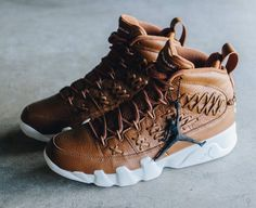 The Air Jordan 9 Baseball Glove in black and brown colorways is featured in more images and it's dropping on July 15.