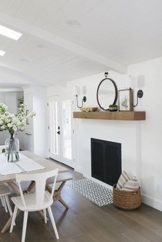 white fireplace, simple, raw wood mantel