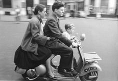 Robert Doisneau   //  French family on two wheel Scooter, 1960,