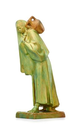 """ZSOLNAY Figurine of a Bedouin woman carrying a jar, eosin glaze, Pecs, Hungary, 1910s  Raised five churches seal/MADE IN HUNGARY/8678, base molded with illegible artist signature  15 1/2"""" x 5"""" x 6 1/2"""""""