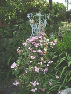 eclecticallyvintage.com / I just love odd trellises, I use an old ladder I painted hot pink, but this is the BEST!!
