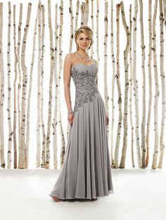 Strapless sweetheart chiffon A-line dress with ruched Empire bust line, intricately hand-beaded and embroidered midriff with asymmetrically dropped waistline, full bias-cut gathered skirt. Matching shawl and removable straps included. Sizes: 4 – 20 - Dress idea for Momma!