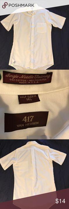 Van Heusen short sleeve dress shirt. Short sleeve button down shirt. Men's neck size 141/2. Left chest pocket. Worn once. No stains, missing buttons, or damage. Smoke free home. Van Heusen Shirts Dress Shirts