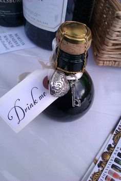 Mini Champagne Bottles from Grays and Feathers    Cute bottle shape. Love the Alice in Wonderland inspired tag.