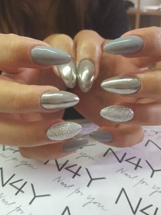 Lovely  nails with silver glitter and chrome pigment for nails