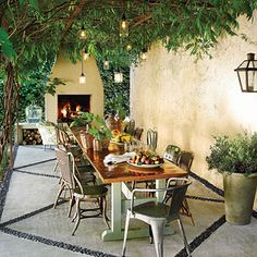 Inviting Patio Makeover | When SL Style Director Heather Chadduck lost a 100-year-old hickory tree in her backyard, she knew it was time for a makeover. A vine-covered pergola and cozy outdoor fireplace transformed her Birmingham backyard into a chic outdoor retreat. | SouthernLiving.com