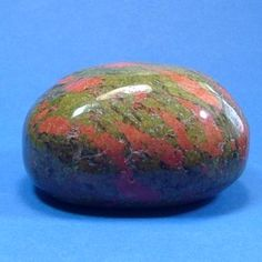 Unakite (or Epidote): can be used to draw off negative energy and blockage from the Heart Chakra. Unakite is said to lift your spirits when you are feeling down - this is the gemstone to help you to see the beauty in life. It is also used to uncover deception.    Used in magic spell casting, unakite will give the user a more confident control of any spell, and the user will find things that have been lost.