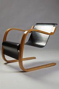 Pair of armchairs designed by Alvar Aalto for Artek, Finland. 1930's.