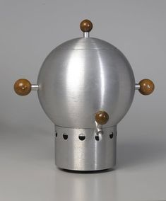 """Russel Wright (American, 1904-1976). """"Coffee Urn"""", ca. 1935. Spun aluminum and walnut, 16 x 13 x 8 1/4 in. (40.6 x 33.0 x 21.0 cm). Brooklyn Museum, Gift of Paul F. Walter, 1994.165.1a-d. Creative Commons-BY (Photo: Brooklyn Museum, 1994.165.1a-d_PS1.jpg)"""