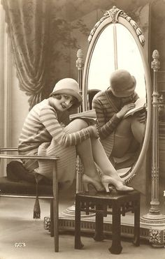 flapper showing her stockings in the reflection.  Repinned by www.lecastingparisien.com