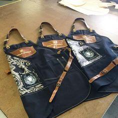 Custom Aprons made for Aunts & Uncles leather bag company Leather Apron, Leather Bag, Barber Apron, Hotel Uniform, Restaurant Uniforms, Shop Apron, Custom Aprons, Just Shop, Linen Apron