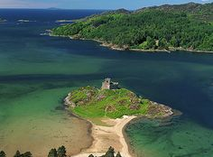 13th century Tioram Castle, Scotland. Pronounced Cheerum . You can walk over at low tide to the castle