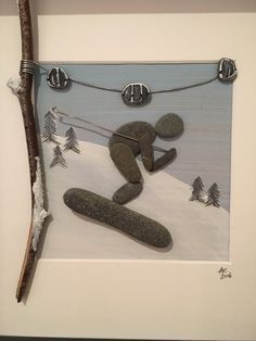 Pebble Art by Alison Cherry  Photographed without glass to avoid reflection. Comes framed with glass  Handpicked from Ballyholme Beach, Co. Down, N.Ireland  Perfect gift for a skiing enthusiast