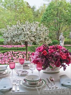 Fine china and linens with a complementary floral color scheme in the garden makes for a perfect touch of romance