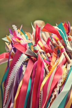 streamers = ribbons on the end of a stick to wave around.