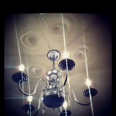 Spray painted chandelier to hang in closet!