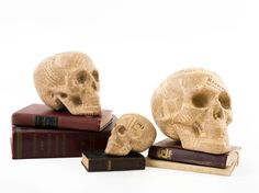 Papier macher takes a macabre turn with these newsprint sculls. What a great Halloween decor idea!