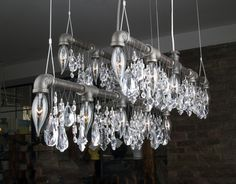 Michael McHale's lighting is a unique mix of industrial style and cool elegance. By pairing plumbing pipe fittings with crystal embellishments, Michael has created light fixtures that walk the line between bohemian and luxury.