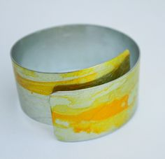 This is one of my Lemon Drizzle Cake anodised aluminium cuffs. It has been handpainted.