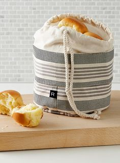 A Canadian design by Ricardo at Simons Maison This rigid fabric bag perfectly replaces the bread basket. Keeps your bread nice and warm with its microwaveable dry bean bag! Linen Towels, Linen Bag, Linen Napkins, Fruit Bowls And Baskets, Bread Bags, Cotton Bag, Cozy House, Pot Holders, Purses And Bags