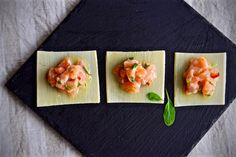 Truffled salmon tartar . Marinated in white wine, ginger, coriander and red pepper on top of a palm heart carpaccio with truffle butter.