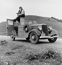 Dorothea Lange, Resettlement Administration photographer, in California atop her 1934 Ford model 40 Woodie with her giant camera, February Many photographs of people in poverty during the Dust Bowl and Depression era were hers. Walker Evans, Dust Bowl, Documentary Photographers, Famous Photographers, Street Photographers, Ansel Adams, Black And White Portraits, Black And White Photography, Old Photos