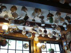 Pannenkoekenhuis Upstairs in Amsterdam with lots of teapots hanging from the ceiling.