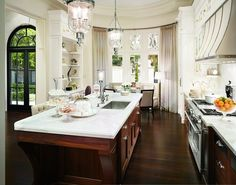 White kitchen with wood furniture island and cabinets.