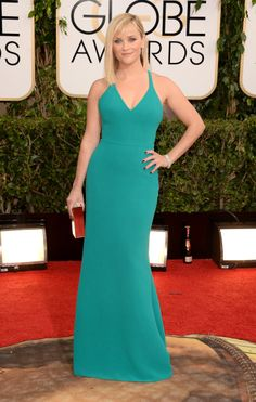 Reese Witherspoon attends the 71st Annual Golden Globe Awards.Wearing: Calvin Klein via StyleList