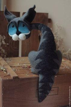 Cat made ​​in the technique of dry felting. Eyes stuff is made ​​and painted by hand also. Cat sits steadily dangling tail.
