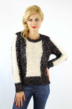 Enewwholesale sells Black and ivory color block crew neck long sleeve knitted sweater. Wholesale fashion women's tops online store with discount price