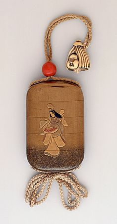Kozan (Japan, born active mid-19th century)   Inro; Ojime; Netsuke, 19th century  Costume/clothing accessory/waistwear, Four-case inro; Shirabyoshi dancer in gold takamakie on gold fundame ground; coral bead ojime; ivory netsuke of Okame in umbrella