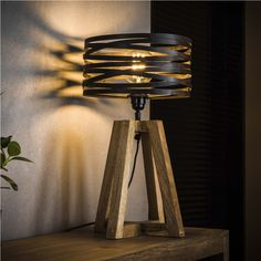 This Watson table lamp has a hood in the form of a spiral with a diameter of 29 centimeters. The Watson table lamp is provided with a wooden base. Industrial Floor Lamps, Industrial Ceiling Lights, Industrial Table, Cosy Home, Rustic Home Design, Steampunk Lamp, Glass Pendant Light, Led Lampe, Living Room Colors