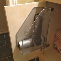 Hair dryer holder! Oh my word! FINALLY! I'm so tired of constantly throwing mine under the sink.
