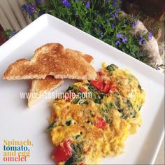 Enjoy this Egg Spinach Tomato Omelet and stay energized throughout the morning! Plus... its 21 Day Fix approved!