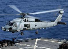 http://upload.wikimedia.org/wikipedia/commons/thumb/9/93/US_Navy_060413-N-9898L-097_An_SH-60B_Seahawk_helicopter_assigned_to_the_Saberhawks_of_Helicopter_Squadron_Light_Four_Seven_%28HSL-47%29_embarked_USS_Abraham_Lincoln_%28CVN_72%29_performs_a_vertical_replenishment.jpg/1024px-thumbnail.jpg