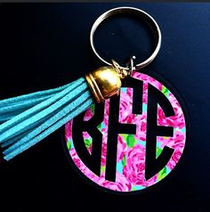 The most adorable keychain personalized with your monogram in Lilly Pulitzer print accented with a matching tassel of your color choice! They make