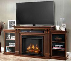 As easy as plugging in a lamp, the Real Flame Ashley Entertainment Center Electric Fireplace - Dark Espresso will transform your entertainment home theater. Based on a best-selling favorite, this entertainment mantel has a classic design and plenty of storage