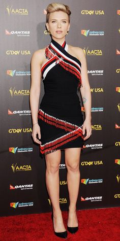 Scarlett Johansson Scarlett Johansson turned heads at the 2015 G'Day USA Gala in a red-black-white curve-hugging Preen dress with fringe detailing and criss-cross halter-neck straps, complete with black Sophia Webster pumps.