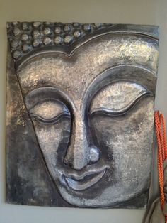 Pewter Buddha wall block (1m x 1m) one of my much loved pieces. Hangs on my patio wall. Mary Ann Lingenfelder Mimmic Gallery and Studio.
