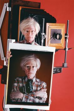 Andy Warhol holding a Polaroid of Andy Warhol. Photo: Bill Ray, 1980.