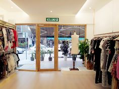Slanted Glass Panel With Wooden Frame Shop Front