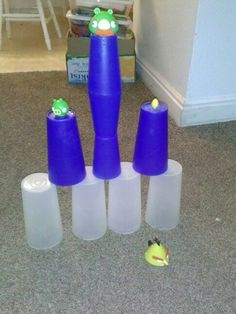 Angry birds real life style! Used cups from the kitchen and pigs and angry birds. Great idea while babysitting boys.